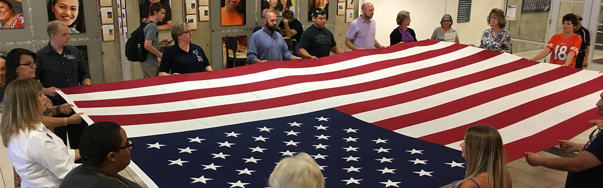 Veterans Club folding the American Flag