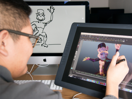 A graphic design student working in the Art and Design Center on the Littleton Campus is animating an illustration of a cartoon monkey.