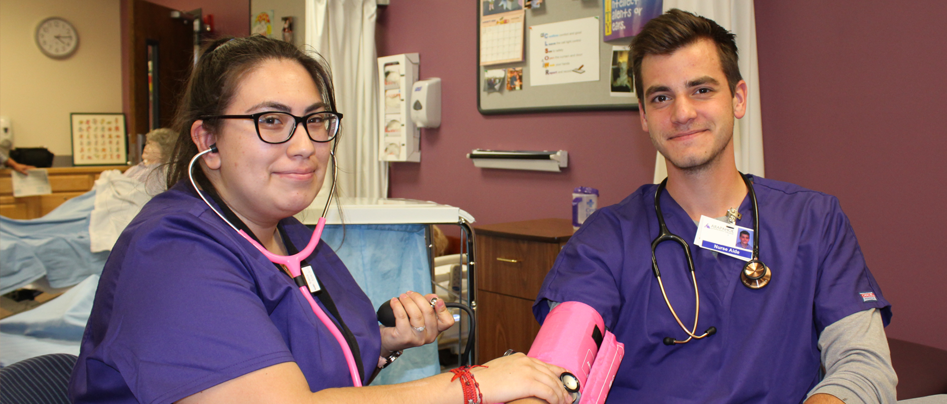 ACC Nurse Aide students taking blood pressure