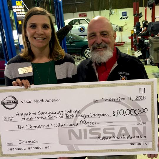 Courtney Loehfelm and Jerry Viola with check from Nissan North America