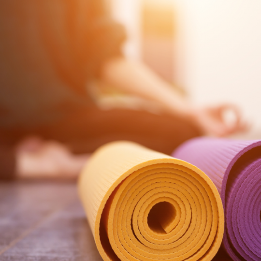 person with yoga mats