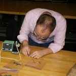 David Colclazier working on electronic components